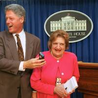 Tables turned: U.S. President Bill Clinton 'interviews' UPI correspondent Helen Thomas in the White House briefing room in August 1995. | AP