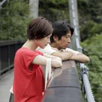 Staring at the abyss: Yoko Maki and Shima Onishi, seen in a still from 'The Ravine of Goodbye,' portray a couple involved in a rape case. | 2013 SAYONARA KEIKOKU SEISAKU IINKAI/KYODO