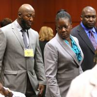 Seeking justice: The parents of Trayvon Martin, Tracy Martin (left) and Sybrina Fulton, arrive for the 16th day of the George Zimmerman trial, with their attorney, Daryl Parks (right), in Seminole circuit court, in Sanford, Florida, on July 1. | AP