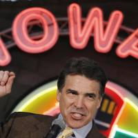 National stage: Texas Gov. Rick Perry makes a campaign stop at the Iowa 80 truck stop in Walcott, Iowa, during his ill-fated bid for the Republican presidential nomination in August 2011. | AP
