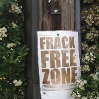 Keep the frack away: An anti-fracking protest sign is seen near Cuadrilla Resources Ltd.'s exploratory shale gas drill site in West Sussex, England, on July 5. Plans to exploit extensive shale gas reserves in the U.K. have divided public opinion. | BLOOMBERG