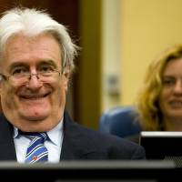 In the dock: Former Bosnian Serb leader Radovan Karadzic sits in the courtroom on the first day of his defense against war crime charges at the International Criminal Tribunal for the Former Yugoslavia in The Hague on Oct. 16, 2012. | AFP-JIJI