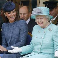 Family affair: Kate, Duchess of Cambridge, shares a light moment with Queen Elizabeth II during a visit to Vernon Park in Nottingham, England, in June 2012. | AP