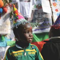 Special day: A schoolchild outside the Medi Clinic Heart Hospital in Pretoria sings a song to former South African President Nelson Mandela to mark his 95th birthday on  Thursday. | AFP-JIJI