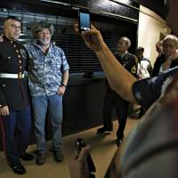For the boys: Ted Nugent poses with members of the military backstage following an April 28 performance in Roanoke, Virginia. | THE WASHINGTON POST