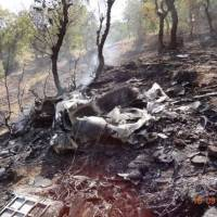 The wreckage of a U.S. Air Force drone that crashed near the Iraqi-Turkish border while tracking Kurdish guerrillas is seen in this video grab from footage posted on YouTube. | THE WASHINGTON POST