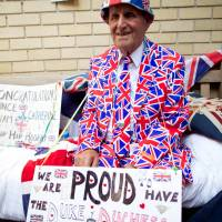 Loud and proud: Royal supporter Terry Hutt poses for a picture outside the Lindo Wing of St. Mary's Hospital in Paddington, west London, on Monday. | AFP-JIJI