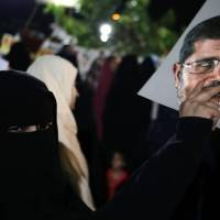 Keeping the faith: Supporters of Egypt's ousted President Mohammed Morsi chant slogans Sunday against Egyptian Defense Minister Gen. Abdel-Fattah el-Sissi at Nasr City, where protesters have set up a camp and hold daily rallies in Cairo. | AP