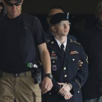 Mixed verdict: U.S. Army Pfc. Bradley Manning is escorted out of a courthouse in Fort Meade, Maryland, on Tuesday after hearing the verdict in his court-martial. | AP