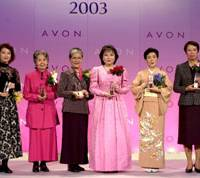 Kuniko Inoguchi (third from right) is honored at the Avon Awards to Women ceremony in 2003. The minister of state for gender equality and social affairs works while her husband does the housekeeping.