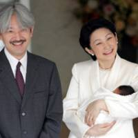Prince Hisahito is cuddled by mom Princess Kiko outside a Tokyo hospital while her husband and the man second in line to the Chrysanthemum Throne, Prince Akishino, looks on.   AP PHOTO