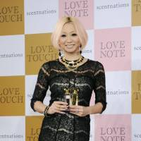 Sweet scent: Singer Kumi Koda attends the launch of her new perfume in December 2012. The singer made a big stink in the media five years earlier when she suggested older women were biologically unsuited to having children. Seen as a gaffe at the time, nowadays it seems women would not react as negatively. | KYODO