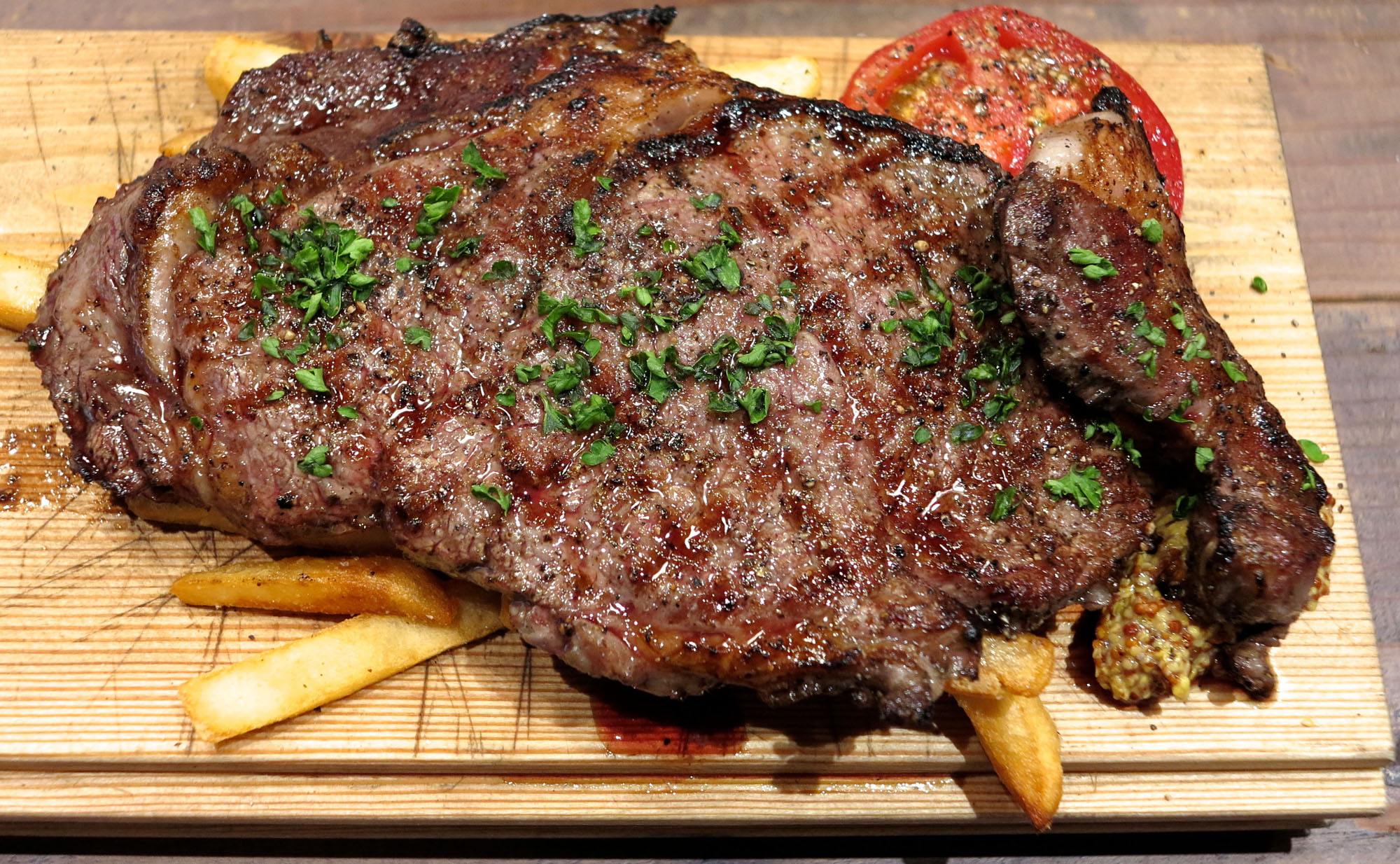 One of many steaks on offer at Butcher Brothers, served on a bed of fries. | ROBBIE SWINNERTON