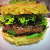 Who needs buns: Keizo Shimamoto and his ramen burger, which he serves to long lines of hungry diners in New York. | COURTESY OF KEIZO SHIMAMOTO