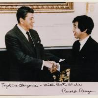 In the White House with President Ronald Reagan, who he interviewed in the mid-1980s when he was the TBS network's Washington bureau chief. | TOYOHIRO AKIYAMA