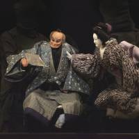 Let them eat cake: A scene from Koki Mitani's 'Much Ado about Love Suicides,' in which puppets portraying manju¯ -store owner Hanbei (center) and his wife (right) face their daughter. | FUTOSHI OSAKO