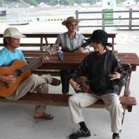 The writer's wife jamming with locals.   HILLEL WRIGHT PHOTO