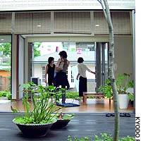 Visitors view a model home with an inner wood-floor court at a housing exhibition in the Tokyo suburb of Musashino last month.