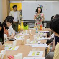 Soaking it up: Participants listen to a lecture at a tasting session organized by the Olive Oil Sommelier Association of Japan on June 22 in Tokyo. | KYODO