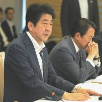 Marching orders: Prime Minister Shinzo Abe addresses a meeting of the Council on Economic and Fiscal Policy at the prime minister's office Thursday. | KYODO