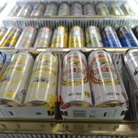 Drink up: Cans of beer made by Kirin Brewery Co. and Asahi Breweries Ltd. are displayed earlier this year at a liquor store in Kawasaki. | BLOOMBERG
