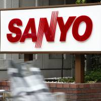 What white goods?: A man passes a Sanyo Electric Co. branch in Tokyo in July 2011. | BLOOMBERG