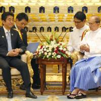 Overtures: Prime Minister Shinzo Abe and Myanmar President Thein Sein hold talks in Naypyitaw, Myanmar, on May 26. | KYODO