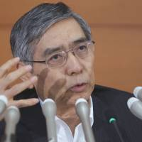 The magic monetizer: Bank of Japan Gov. Haruhiko Kuroda gestures at a news conference at BOJ headquarters in Tokyo on Aug. 8 as he warned against delaying the first stage of the consumption tax hike. | BLOOMBERG
