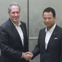 Talking trade: U.S. Trade Representative Michael Froman is greeted by Akira Amari, minister of state for economic and fiscal policy, ahead of their Monday meeting in Tokyo. | BLOOMBERG