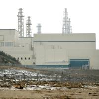 Risky business: Tokyo Electric Power Co. is at least four months behind schedule in restarting reactors at its Kashiwazaki-Kariwa nuclear plant in Niigata Prefecture. | BLOOMBERG
