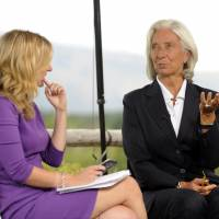 Sobering message: Christine Lagarde, managing director of the International Monetary Fund, gestures while being interviewed by Sarah Eisen of Bloomberg News at the Jackson Hole economic symposium sponsored by the Kansas City Federal Reserve Bank at the Jackson Lake Lodge in Moran, Wyoming, on Friday. | BLOOMBERG