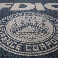 In pursuit: The Federal Deposit Insurance Corp. logo is displayed outside the agency's headquarters in Washington. | BLOOMBERG