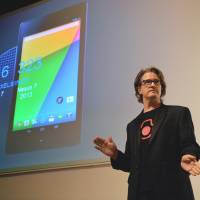 Japan-bound: Chris Yerga, Google's engineering director, speaks in Tokyo on Monday while standing in front of an image of the new Nexus 7 tablet computer. The Nexus 7, produced by Taiwanese maker Asus, will go on sale in Japan on Wednesday. | AFP-JIJI