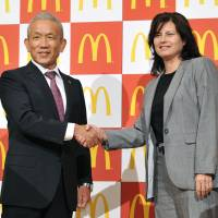 I'm lovin' it: McDonald's Holdings Co. (Japan) Chairman Eiko Hara poses for a photo with the firm's new president, Sarah Casanova, in Tokyo on Tuesday. | KYODO