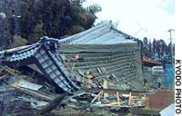 A house lies in ruins after being destroyed by an early morning gale in Utsunomiya, Tochigi Prefecture. Two people sleeping inside suffered minor injsuries.