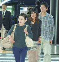 Relatives of two Japanese journalists reported killed in Iraq - Shinsuke Hashida and Kotaro Ogawa - arrive Saturday at Narita airport before leaving for Kuwait. From left are Hashida's wife, Yukiko, his younger sister, Yoko, who is also Ogawa's mother, and Hashida's eldest son, Daisuke.
