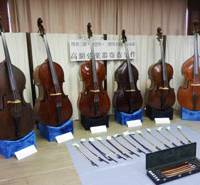 Fiddler on the hoof: Stolen double basses and other items confiscated from the home of a man in Atsugi, Kanagawa Prefecture, are shown to the media Tuesday at the Mitaka Police Station in western Tokyo. | KYODO PHOTO
