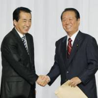 Gloves off: Prime Minister Naoto Kan (left) and rival Ichiro Ozawa meet as they kick off their campaigns Wednesday in Tokyo for the Democratic Party of Japan presidency. | KYODO PHOTO