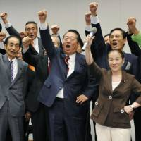 Kickoff: Ichiro Ozawa leads a cheer from his followers Wednesday in Tokyo as the campaign began for the Democratic Party of Japan's presidential election on Sept. 14. | KYODO PHOTO