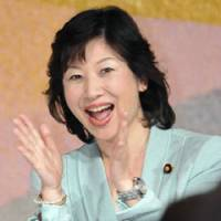 Expecting: Seiko Noda, a Liberal Democratic Party lawmaker, smiles at a political fundraising party Friday in Tokyo where she officially announced her pregnancy. Bellow, an embryologist cultivates embryos at Suwa Maternity Clinic in Nagano Prefecture.   KYODO PHOTO, COURTESY OF SUWA MATERNITY CLINIC