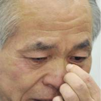 Borrowed time: Lower House member Muneo Suzuki tears up at a news conference Wednesday in Tokyo after the Supreme Court refused to overturn his bribery conviction. | KYODO PHOTO