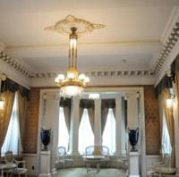 Princely decor: A French-style reception room next to the Guest House's entrance hall has a semicircular alcove.