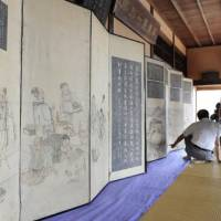 Historical treasures: A pair of screens depicting a town by the Seto Inland Sea and a visiting Korean delegation in the early 19th century are unveiled in Fukuyama, Hiroshima Prefecture, on Wednesday. | KYODO PHOTO