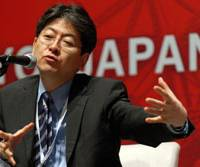 Broader reach: Oki Matsumoto, chief executive officer of Monex Group Inc., speaks at a business conference in Tokyo. He is urging Japanese to learn 'globish' as a solution to the country's stagnant economy. | BLOOMBERG