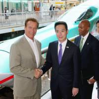The big time: Seiji Maehara shakes hands with Calif. Gov. Arnold Schwarzenegger Tuesday at JR Tokyo Station, when he was still transport minister. He was named foreign minister Friday. | KYODO PHOTO
