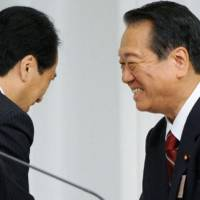 Crocodile smiles: Democratic Party of Japan kingpin Ichiro Ozawa shares smiles with Prime Minister Naoto Kan on Tuesday after losing to him in the ruling party's presidential election. | KYODO PHOTO
