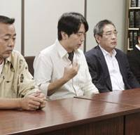 Post-trial review: Two lay judges (at right) and two alternates speak to reporters after actor Manabu Oshio was sentenced to 2 1/2 years in prison Friday. | KYODO PHOTO
