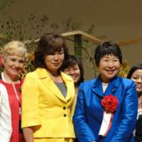 Leading the way: Yukako Uchinaga (left), chair of the three-day APEC Women Leaders Network meeting in Tokyo, poses on Sunday with Tomiko Okazaki, Cabinet minister in charge of gender equality. | KAZUAKI NAGATA