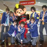 It's a kid's world: Members of Fudanjuku (Rotten Boys Cram School) pose with toy character Monchhichi last Thursday at the temporary Kiddy Land shop in Tokyo's Harajuku district. At right is a view of the store's exterior.   MINORU MATSUTANI PHOTO