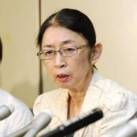 Center of the storm: Atsuko Muraki, a senior welfare ministry official recently cleared of involvement in abuse of the mail discount system for disabled people, holds a news conference Tuesday in Tokyo. | KYODO PHOTO